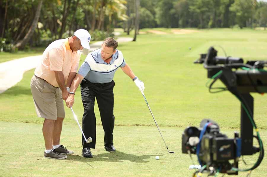 Michael Breed gives Al Del Greco some instruction.