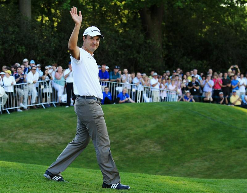 VIRGINIA WATER, ENGLAND - MAY 23:  Simon Khan of England celebrates as he steps forward to accept the trophy following his victory in the BMW PGA Championship on the West Course at Wentworth on May 23, 2010 in Virginia Water, England.  (Photo by Warren Little/Getty Images)