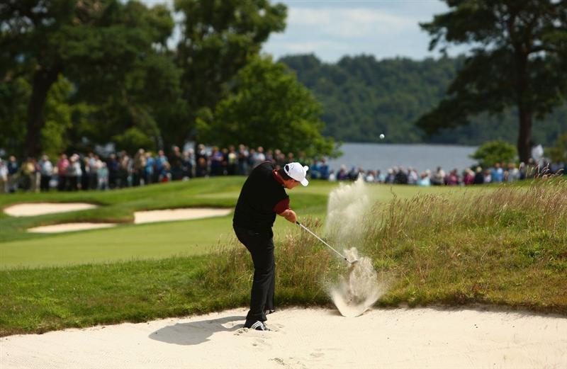 LUSS, UNITED KINGDOM - JULY 09:  Paul Lawrie of Scotland hits out of a bunker on the 1st hole during the First Round of The Barclays Scottish Open at Loch Lomond Golf Club on July 09, 2009 in Luss, Scotland. (Photo by Richard Heathcote/Getty Images)