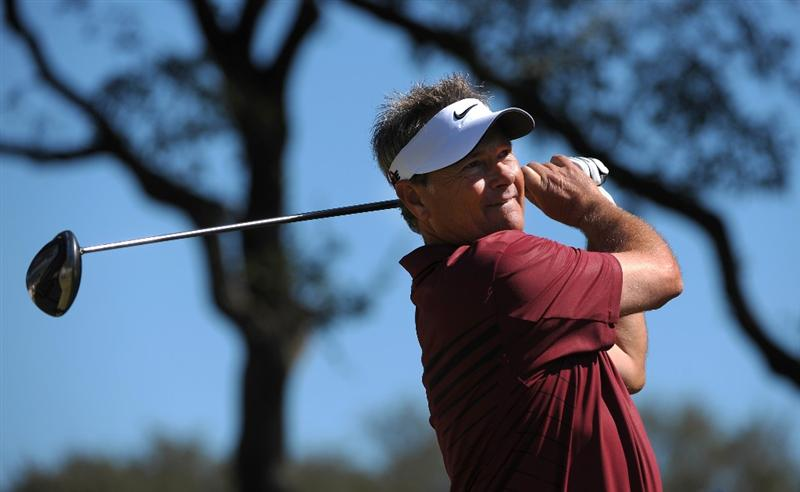 SAN ANTONIO - OCTOBER 24: John Cook makes a tee shot on the fifth hole during the second round of the PGA Champions Tour AT&T Championship at the Oak Hills Country Club on October 24, 2009 in San Antonio, Texas.  (Photo by Robert Laberge/Getty Images)