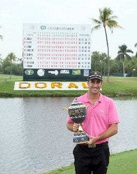 MIAMI - MARCH 24:  Geoff Ogilvy of Australia holds the trophy after the completion of the final round of the 2008 World Golf Championships CA Championship at the Doral Golf Resort & Spa, on March 24, 2008 in Miami, Florida.  (Photo by David Cannon/Getty Images)