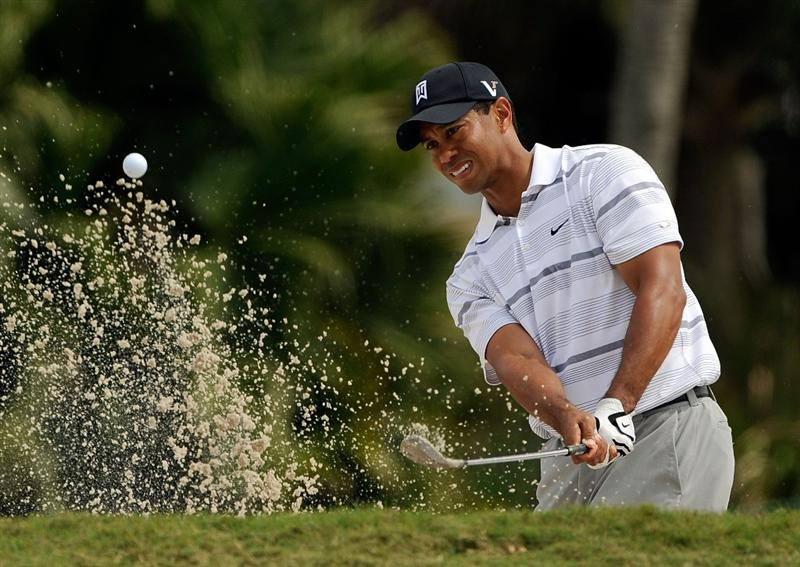 DORAL, FL - MARCH 12:  Tiger Woods plays a shot from the bunker on the 13th hole during the first round of the World Golf Championships-CA Championship at the Doral Golf Resort & Spa on March 12, 2009 in Miami, Florida.  (Photo by Sam Greenwood/Getty Images)