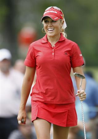 SYLVANIA, OH - JULY 03: Natalie Gulbis reacts to a birdie putt on the 15th green during the second round of the Jamie Farr Owens Corning Classic at Highland Hills Golf Club on July 3, 2009 in Sylvania, Ohio. (Photo by Gregory Shamus/Getty Images)