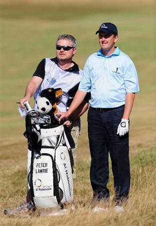 ZANDVOORT, NETHERLANDS - AUGUST 22:  Peter Lawrie of Ireland and caddie on the 13th hole during the third round of The KLM Open at Kennemer Golf & Country Club on August 22, 2009 in Zandvoort, Netherlands.  (Photo by Stuart Franklin/Getty Images)