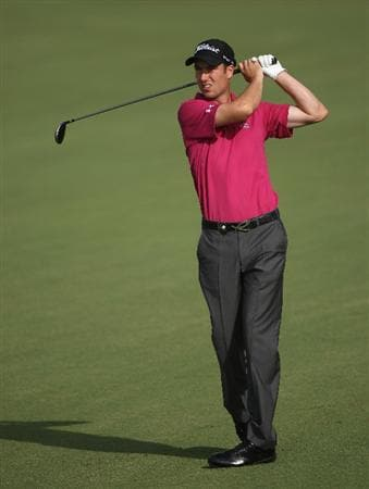 DUBAI, UNITED ARAB EMIRATES - NOVEMBER 21:  Ross Fisher of England hits his second shot on the second hole during the third round of the Dubai World Championship on the Earth Course, Jumeirah Golf Estates on November 21, 2009 in Dubai, United Arab Emirates.  (Photo by Andrew Redington/Getty Images)