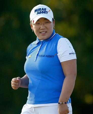 RICHMOND, TX - NOVEMBER 22:  Jiyai Shin of South Korea smiles after a birdie putt on the 12th hole during completion of the weather-delayed second round of the LPGA Tour Championship presented by Rolex at the Houstonian Golf and Country Club on November 22, 2009 in Richmond, Texas.  (Photo by Scott Halleran/Getty Images)