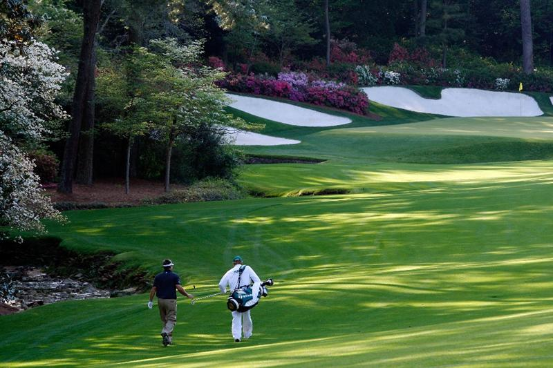 AUGUSTA, GA - APRIL 11:  Kenny Perry walks with his caddie Fred Sanders on the 13th hole during the third round of the 2009 Masters Tournament at Augusta National Golf Club on April 11, 2009 in Augusta, Georgia.  (Photo by Jamie Squire/Getty Images)