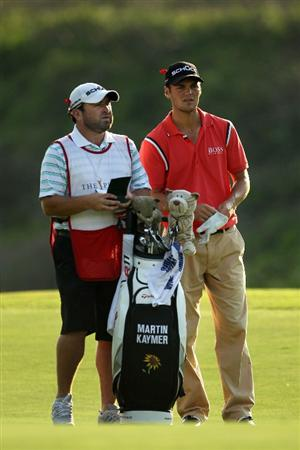 PONTE VEDRA BEACH, FL - MAY 14:  Martin Kaymer of Germany waits in a fairway with his caddie Craig Connelley during the third round of THE PLAYERS Championship held at THE PLAYERS Stadium course at TPC Sawgrass on May 14, 2011 in Ponte Vedra Beach, Florida.  (Photo by Mike Ehrmann/Getty Images)