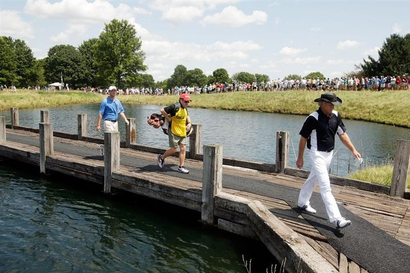 CARMEL, IN - AUGUST 02:  Greg Norman of Australia walks across a bridge to the teebox on the 4th hole during the final round of the 2009 U.S. Senior Open on August 2, 2009 at Crooked Stick Golf Club in Carmel, Indiana.  (Photo by Jamie Squire/Getty Images)