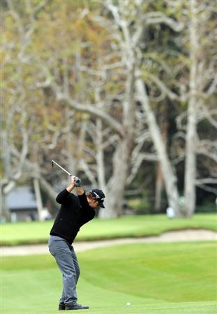 PACIFIC PALISADES, CA - FEBRUARY 18:  Ryan Moore plays his approach shot on the 15th hole during the second round of the Northern Trust Open at Riviera Country Club on February 18, 2011 in Pacific Palisades, California.  (Photo by Stuart Franklin/Getty Images)