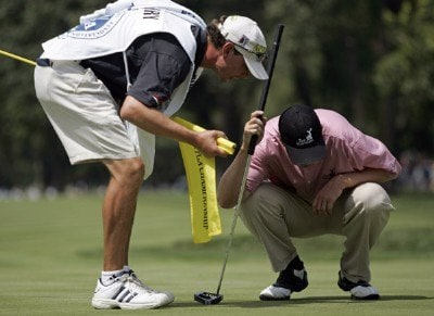 J.J. Henry and his caddy during the first round of the 88th PGA Championship at Medinah Country Club in Medinah, Illinois, on August 17, 2006.Photo by Hunter Martin/WireImage.com
