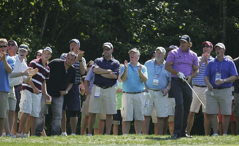 NORTON, MA - SEPTEMBER 04:  Phil Mickelson of the United States watches his shot from the rough during the first round of the Deutsche Bank Championship at TPC Boston held on September 4, 2009 in Norton, Massachusetts.  (Photo by Michael Cohen/Getty Images)