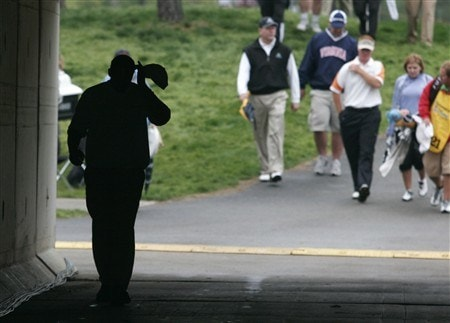 GLEN ALLEN, VA - APRIL 27: Tom Gillis (L) scratches his head as he walks through a tunnel on his way to tee off on the 17th hole during the final round of the Henrico County Open of the Nationwide Tour at The Dominion Club April 27, 2008 in Glen Allen, Virginia. (Photo by Chris Gardner/Getty Images)