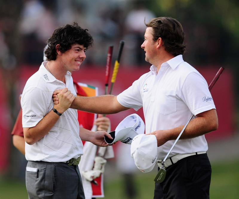 SHENZHEN, GUANGDONG - NOVEMBER 26:  Rory McIlroy and Graeme McDowell of Northern Ireland celebrate on the 18th hole during Fourball on the first day of the Omega Mission Hills World Cup on the Olazabal course on November 26, 2009 in Shenzhen, China.  (Photo by Stuart Franklin/Getty Images)