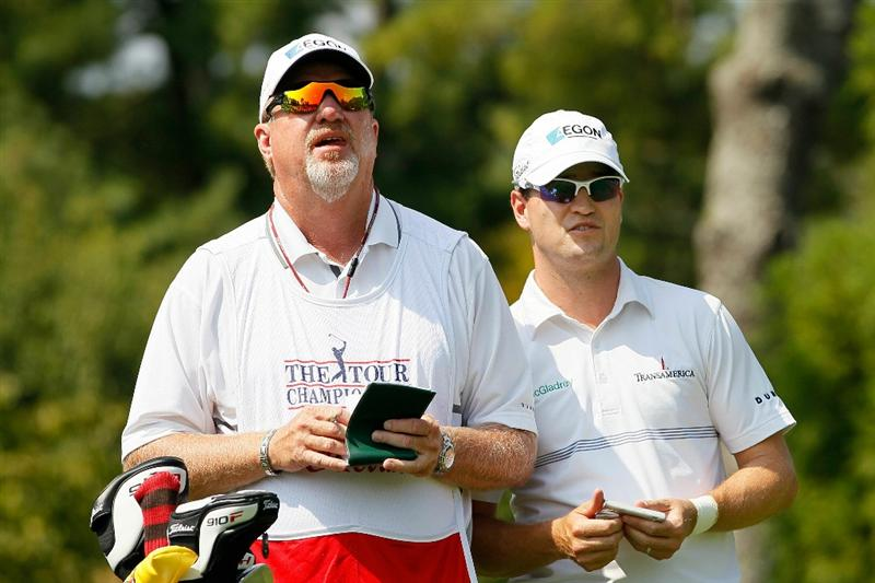 ATLANTA - SEPTEMBER 23:  Zach Johnson (R) looks on with caddie Damon Green from the second tee during the first round of THE TOUR Championship presented by Coca-Cola at East Lake Golf Club on September 23, 2010 in Atlanta, Georgia.  (Photo by Kevin C. Cox/Getty Images)