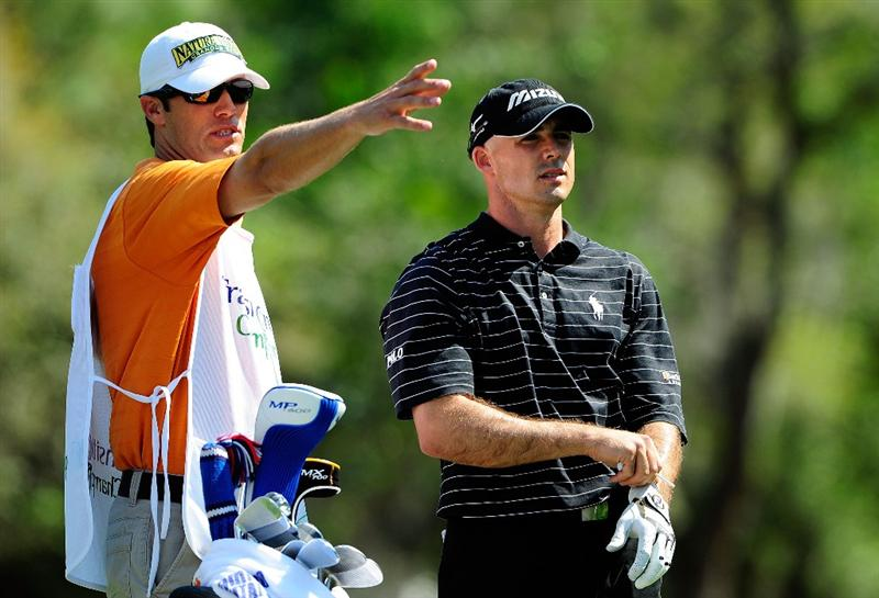 PALM HARBOR, FL - MARCH 20:  Jonathan Byrd checks the yardage prior to playing a shot on the 9th hole during the second round of the Transitions Championship at the Innisbrook Resort and Golf Club on March 20, 2009 in Palm Harbor, Florida.  (Photo by Sam Greenwood/Getty Images)