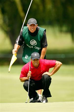 GRAND BLANC, MI - AUGUST 02:  Tiger Woods and his caddy Steve Williams line up a putt on the 4th hole during the final round of the Buick Open at Warwick Hills Golf and Country Club on August 2, 2009 in Grand Blanc, Michigan.  (Photo by Chris Graythen/Getty Images)