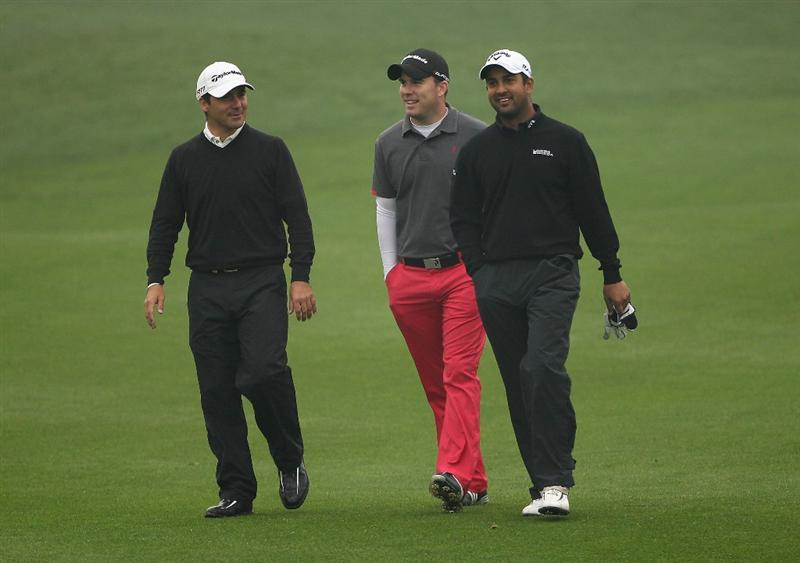 ICHEON, SOUTH KOREA - APRIL 30:  (L-R) Felipe Aguilar of Chile; Richie Ramsay of Scotland and Shiv Kapur of India share a joke during the third round of the Ballantine's Championship at Blackstone Golf Club on April 30, 2011 in Icheon, South Korea.  (Photo by Andrew Redington/Getty Images)
