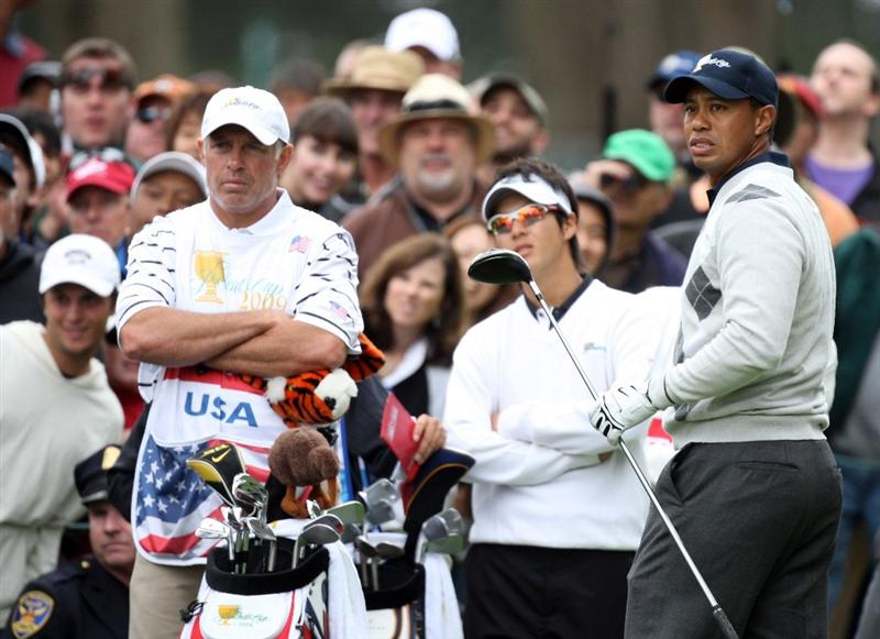 SAN FRANCISCO - OCTOBER 10:  Tiger Woods of the USA plays his tee shot at the 6th hole watched by his opponent Ryo Ishikawa of Japan  and the International Team during the Day Three Afternoon Fourball Matches in The Presidents Cup at Harding Park Golf Course on October 10, 2009 in San Francisco, California  (Photo by David Cannon/Getty Images)