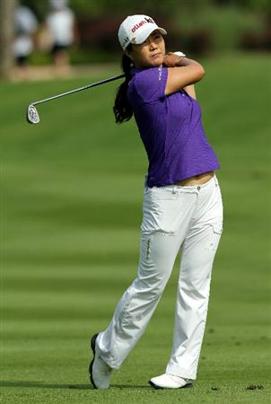 KUALA LUMPUR, MALAYSIA - OCTOBER 23: Meena Lee of Korea Republic hits her 2nd shot on the 1st hole during Round Two of the Sime Darby LPGA on October 23, 2010 at the Kuala Lumpur Golf and Country Club in Kuala Lumpur, Malaysia. (Photo by Stanley Chou/Getty Images)