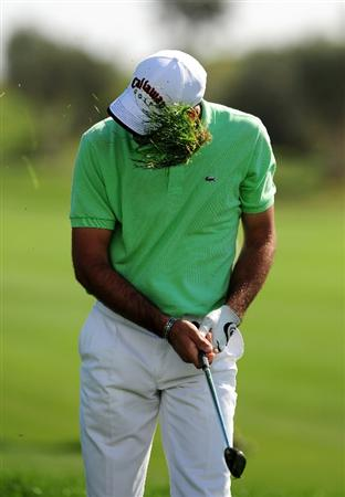 VILAMOURA, PORTUGAL - OCTOBER 18:  Alvaro Quiros of Spain gets a divot in the face as he plays from deep rough on the 3rd during the third round of the Portugal Masters at the Oceanico Victoria Golf Course on October 18, 2008 in Vilamoura, Portugal.  (Photo by Richard Heathcote/Getty Images)