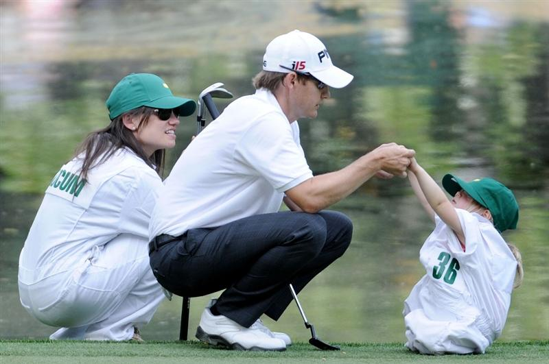 AUGUSTA, GA - APRIL 07:  Heath Slocum plays with his daughter Stella alongside his wife Victoria during the Par 3 Contest prior to the 2010 Masters Tournament at Augusta National Golf Club on April 7, 2010 in Augusta, Georgia.  (Photo by Harry How/Getty Images)