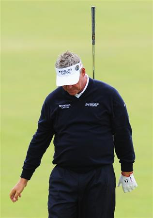 TURNBERRY, SCOTLAND - JULY 18:  Darren Clarke of Northern Ireland reacts to a shot during round three of the 138th Open Championship on the Ailsa Course, Turnberry Golf Club on July 18, 2009 in Turnberry, Scotland.  (Photo by Stuart Franklin/Getty Images)