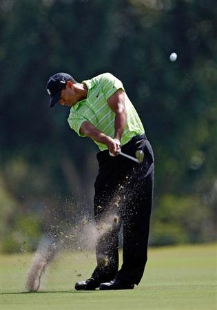 DORAL, FL - MARCH 14:  Tiger Woods hits is second shot on the 6th hole during the third round of the World Golf Championships-CA Championship on March 14, 2009 at the Doral Golf Resort and Spa in Miami, Florida.  (Photo by Jamie Squire/Getty Images)