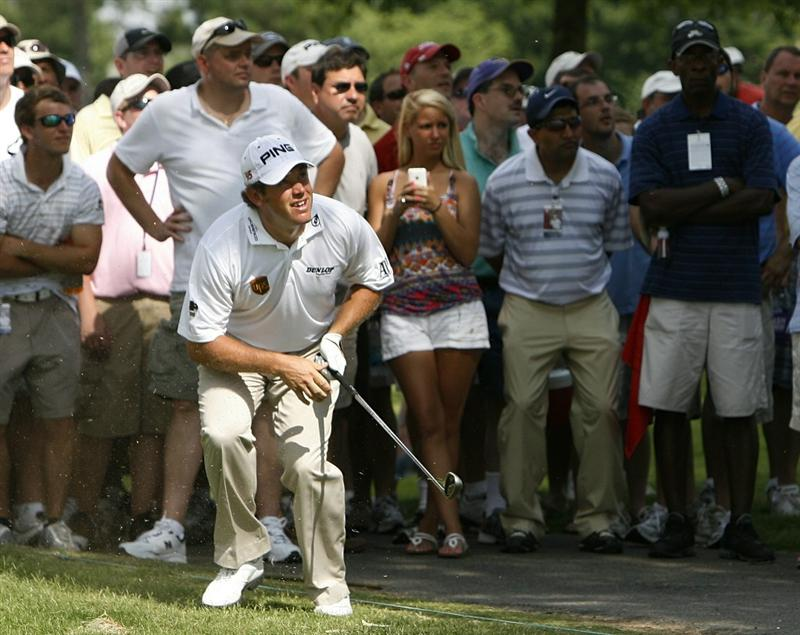 MEMPHIS, TN - JUNE 13: Lee Westwood of England watches his second shot out of the crowd on the 16th hole during the final round of the St. Jude Classic at TPC Southwind held on June 13, 2010 in Memphis, Tennessee.  (Photo by John Sommers II/Getty Images)