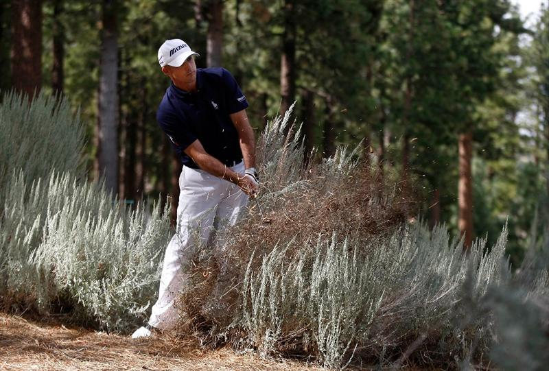 RENO, NV - AUGUST 06:  Jonathan Byrd hits out of the bushes on the 6th hole during the first round of the Legends Reno-Tahoe Open on August 6, 2009 at Montreux Golf and Country Club in Reno, Nevada.  (Photo by Jonathan Ferrey/Getty Images)