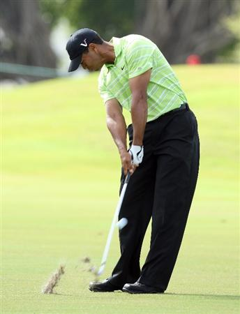 DORAL, FL - MARCH 14:  Tiger Woods of the USA hits his second shot at the 1st hole during the third round of the World Golf Championships-CA Championship at the Doral Golf Resort & Spa on March 14, 2009 in Miami, Florida  (Photo by David Cannon/Getty Images)