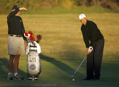 North and South American Editorial Sales Only,  Tiger Woods and his caddie Steve Williams look over a shot on the second fairway of the north course during a practice round for the Buick Invitational golf tournament at Torrey Pines in La Jolla, California January 23, 2007Photo by Reuters/WireImage.com