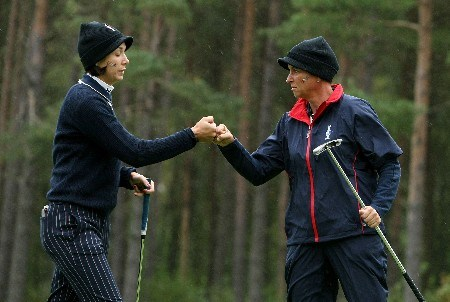 HALMSTAD, SWEDEN - SEPTEMBER 14:  Laura Diaz is congratulated by Sherri Steinhauer after making a putt on the 11th hole during the morning foursomes at the Solheim Cup at Halmstad Golf Club on September 14, 2007 in Halmstad, Sweden.  (Photo by Jonathan Ferrey/Getty Images)
