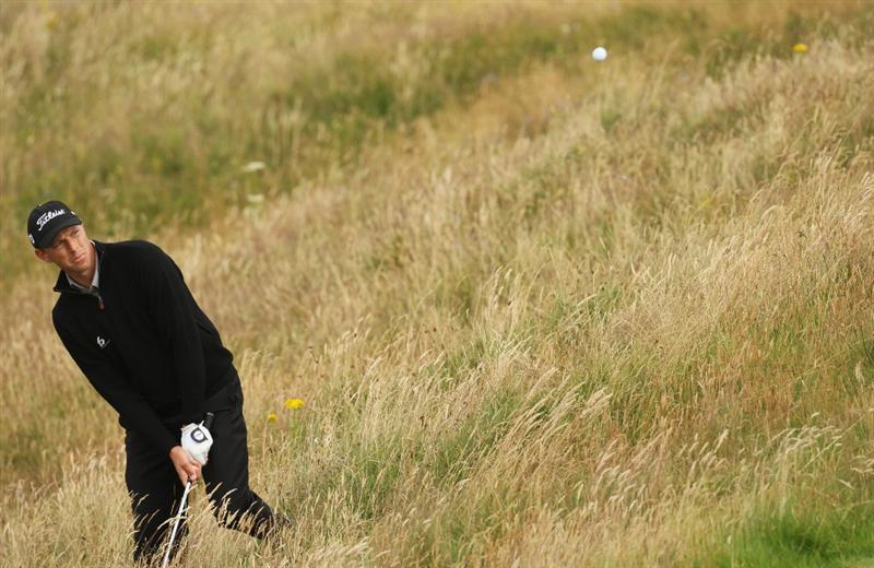 TURNBERRY, SCOTLAND - JULY 14:  Soren Hansen of Denmark hits from the rough during a practice round prior to the 138th Open Championship on the Ailsa Course, Turnberry Golf Club on July 14, 2009 in Turnberry, Scotland.  (Photo by Ross Kinnaird/Getty Images)