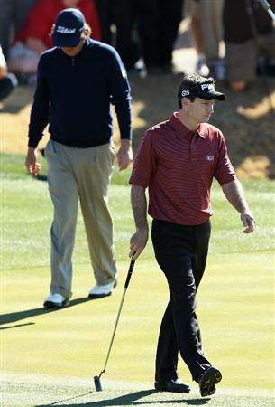 SCOTTSDALE, AZ - FEBRUARY 07:  Mark Wilson (R) walks on the 18th hole green during the first playoff hole against Jason Dufner in the Waste Management Phoenix Open at TPC Scottsdale on February 7, 2011 in Scottsdale, Arizona.  (Photo by Christian Petersen/Getty Images)