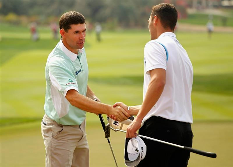 ABU DHABI, UNITED ARAB EMIRATES - JANUARY 20:  Padraig Harrington of Ireland (L) shakes hands with Martin Kaymer of Germany on the 18th green during the first round of the 2011 Abu Dhabi HSBC Golf Championship at the Abu Dhabi Golf Club on January 20, 2011 in Abu Dhabi, United Arab Emirates.  (Photo by Scott Halleran/Getty Images)