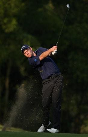 SHENZHEN, CHINA - NOVEMBER 27:  Alastair Forsyth of Scotland plays his approach shot during the first round of the Omega Mission Hills World Cup at the Mission Hills Resort on 27 November 2008 in Shenzhen, China.  (Photo by Stuart Franklin/Getty Images)