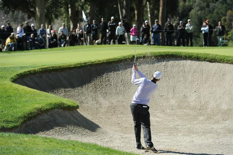 PACIFIC PALISADES, CA - FEBRUARY 20:  Justin Rose of England plays his bunker shot on the fourth hole during the final round of the Northern Trust Open at Riviera Country Club on February 20, 2011 in Pacific Palisades, California.  (Photo by Stuart Franklin/Getty Images)