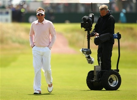 SOUTHPORT, UNITED KINGDOM - JULY 19:  Ian Poulter of England is watched by a cameraman on the 1st during the third round of the 137th Open Championship on July 19, 2008 at Royal Birkdale Golf Club, Southport, England.  (Photo by Richard Heathcote/Getty Images)