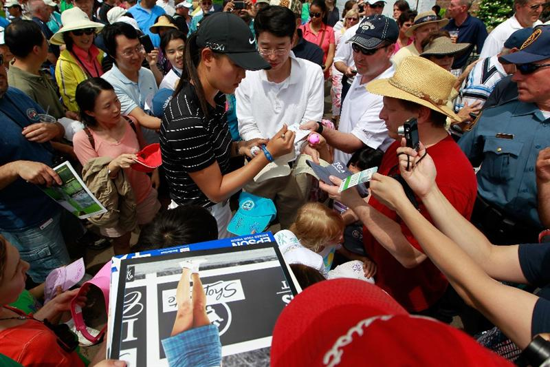 GLADSTONE, NJ - MAY 21:  Michelle Wie signs autographs for fans following round three of the Sybase Match Play Championship at Hamilton Farm Golf Club on May 21, 2011 in Gladstone, New Jersey.  (Photo by Chris Trotman/Getty Images)