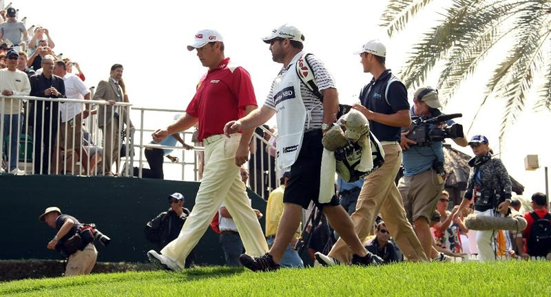 DUBAI, UNITED ARAB EMIRATES - FEBRUARY 10:  Lee Westwood of England and Martin Kaymer of Germany make their way off of the first tee during the first round the Omega Dubai Desert Classic on the Majlis course at the Emirates Golf Club on February 10, 2011 in Dubai, United Arab Emirates.  (Photo by Ross Kinnaird/Getty Images)