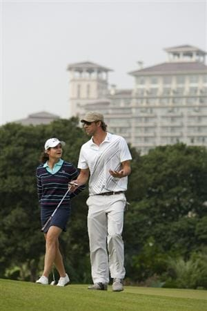 HAIKOU, CHINA - OCTOBER 31:  Lorena Ochoa of Mexico and Michael Phelps of USA talk during day five of the Mission Hills Start Trophy tournament at Mission Hills Resort on October 31, 2010 in Haikou, China. The Mission Hills Star Trophy is Asia's leading leisure liflestyle event which features Hollywood celebrities and international golf stars.  (Photo by Athit Perawongmetha/Getty Images for Mission Hills)