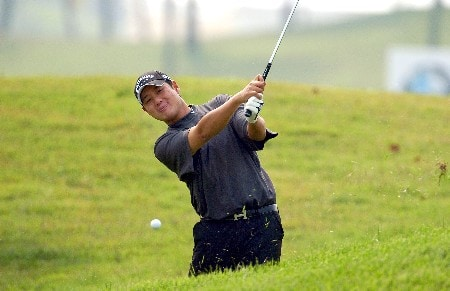 Eddie Lee from New Zealand duffs a shot out of the rough on the 2nd during Round 2.Photo by Jeff Crow/WireImage.com