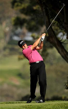 LA JOLLA, CA - JANUARY 31:  Robert Allenby of Australia hits his tee shot on the fifth hole on the South Course at Torrey Pines Golf Course during the final round of the Farmers Insurance Open on January 31, 2010 in La Jolla, California.  (Photo by Stephen Dunn/Getty Images)