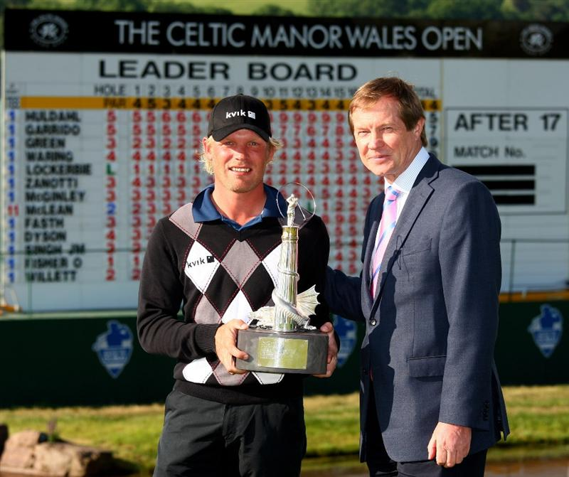 NEWPORT, WALES - JUNE 07:  Jeppe Huldahl of Denmark poses with the trophy and George O'Grady, Chief Executive of The European Tour after the final round of the Celtic Manor Wales Open on the 2010 Course at The Celtic Manor Resort on June 7, 2009 in Newport, Wales.  (Photo by Richard Heathcote/Getty Images)