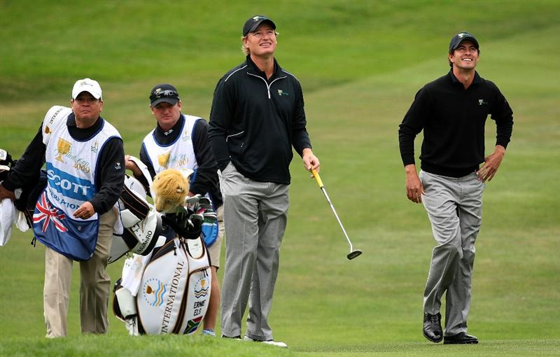 SAN FRANCISCO - OCTOBER 08:  Ernie Els and Adam Scott of the International Team waits in the first fairway with their caddies during the Day One Foursome Matches of The Presidents Cup at Harding Park Golf Course on October 8, 2009 in San Francisco, California.  (Photo by David Cannon/Getty Images)