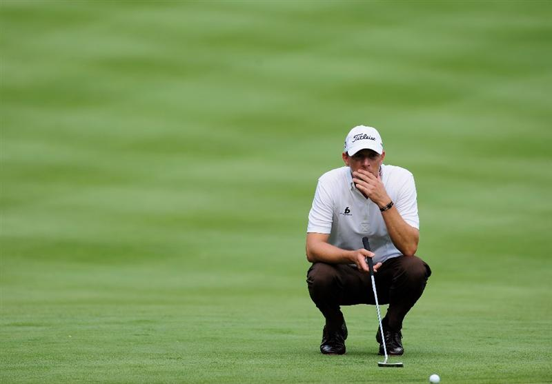 AKRON, OH - AUGUST 06:  Soren Hansen of Denmark ponders his putt on the sixth hole during the first round of the World Golf Championship Bridgestone Invitational on August 6, 2009 at Firestone Country Club in Akron, Ohio.  (Photo by Stuart Franklin/Getty Images)