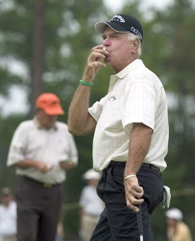 Bruce Fleisher kisses his golf ball after making a par putt on the 18th hole during the first round of the 2005 SAS Championship Friday, September 30, 2005, at Prestonwood Country Club in Cary, North Carolina.Photo by Grant Halverson/WireImage.com