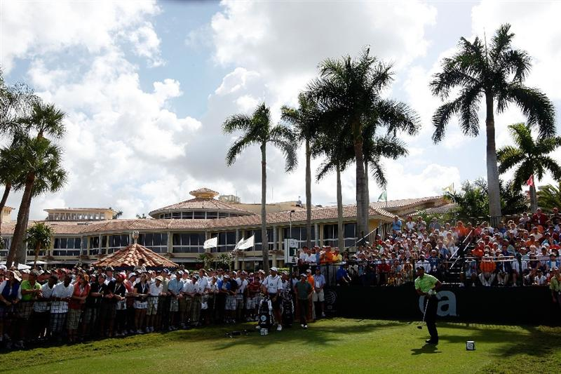 DORAL, FL - MARCH 14:  Tiger Woods hits his first shot on the 1st hole during the third round of the World Golf Championships-CA Championship on March 14, 2009 at the Doral Golf Resort and Spa in Miami, Florida.  (Photo by Jamie Squire/Getty Images)