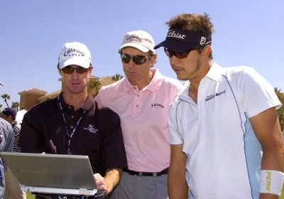 Golf instructor David Leadbetter (center) and Fredrik Jacobson (right) check a swing on a computer  after a practice round  at the 2006 Honda Classic March 7 at the Country Club at Mirasol in Palm Beach Gardens, Florida.Photo by Al Messerschmidt/WireImage.com
